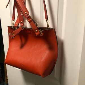 Rust orange Calvin Klein bag with pouch